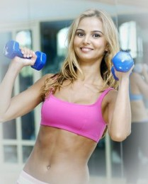 female holding a pair of dumbbells