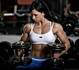 female performing seated dumbbell curls